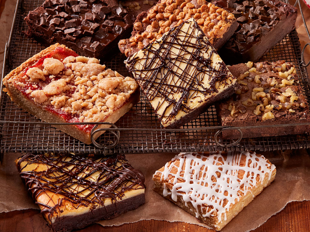 The most amazing gourmet brownies are now at Bake Me A Wish! An 8 piece selection of scrumptious brownies that are sure to be a crowd pleaser. We include Velvet Ganache Chocolate, Cheesecake, Peanut Butter Crunch, Fudge Walnut, Iced Lemon Blondie and Raspberry Crumb! This outstanding array arrives packaged in an elegant gift box. Order online for nationwide delivery!