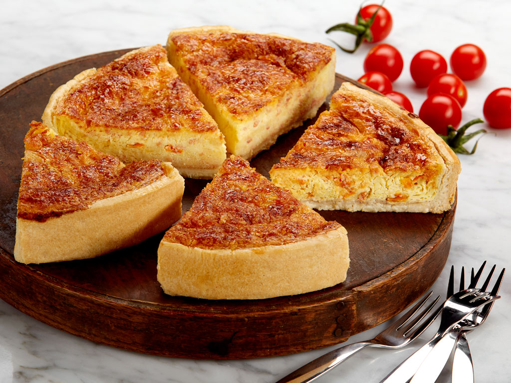 Savory, delicately seasoned creamy egg custard swirled with Cheddar cheese, soy bacon crumbles, tomato and a touch of onion in a tender, flaky pastry crust. Each quiche arrives in the Bake Me A Wish box with the message of your choice. Order online for nationwide delivery!