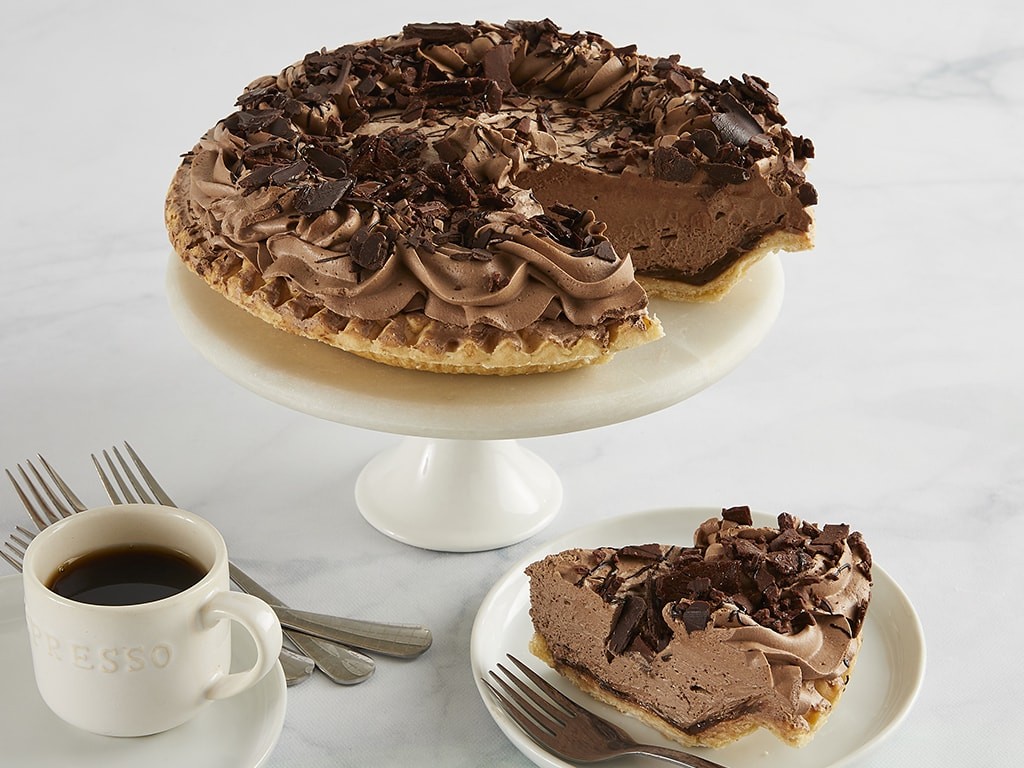 An exquisite indulgence to our delicious roster of pies! We start with a chocolate crust, then layer in dreamy chocolate mousse to the brim and finish with delicious chocolate shaves! Each pie arrives in an elegant bakery box with a greeting card that you can personalize online. Order online for nationwide delivery!